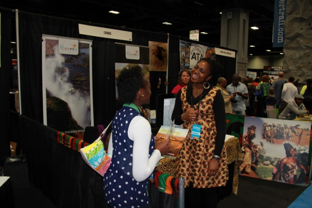 First Secretary-Tourism shares a joke with a visitor at the Zambia booth during the Washington DC Adventure show (640x427)